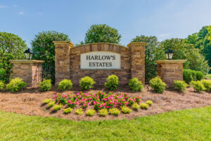 Harlow's Crossing The Estates Entrance